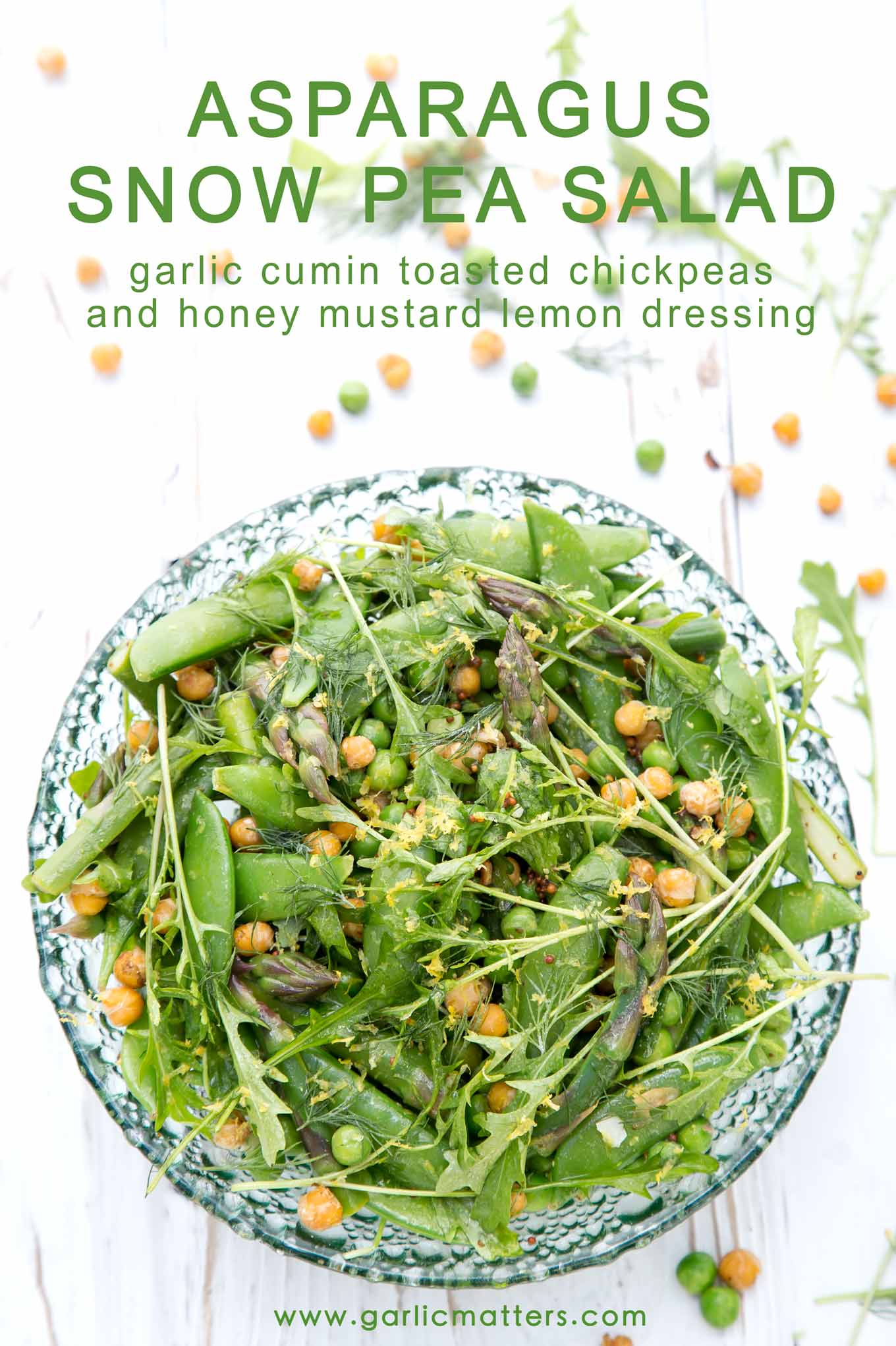 20 min, Asparagus and Snow Pea Salad with garlic cumin toasted chickpeas and honey mustard lemon dressing. Vegan deliciousness!