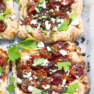 CHERRY TOMATO TARTS WITH BLACK GARLIC HONEY DRESSING RECIPE