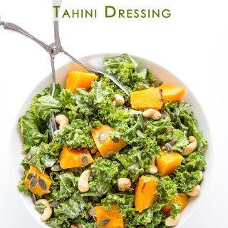 KALE AND PUMPKIN SALAD WITH ROASTED GARLIC TAHINI DRESSING