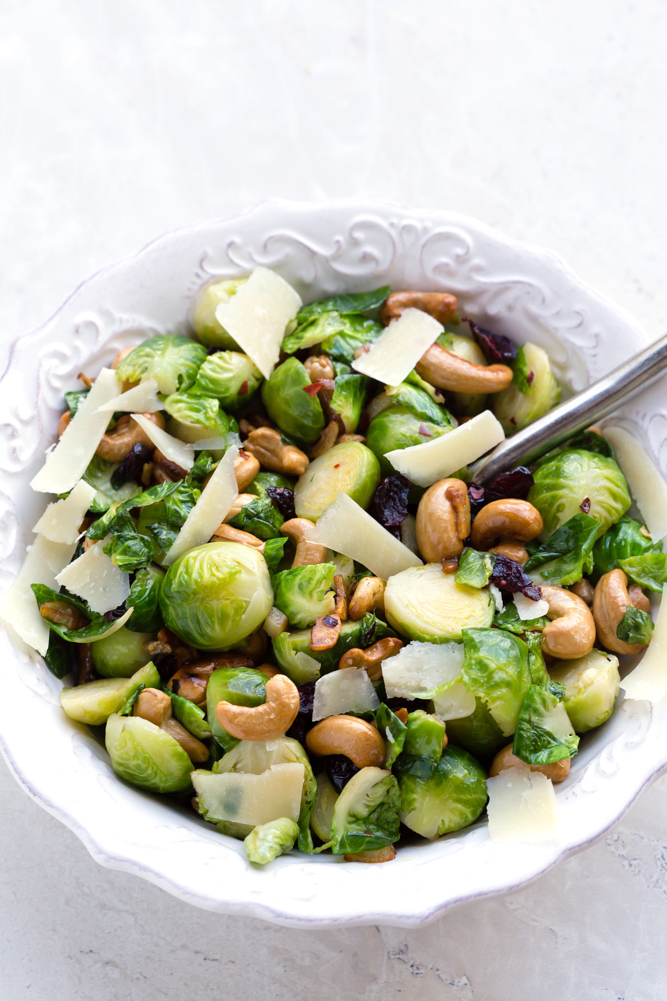 this is the best brussels sprout salad with nuts cranberries parmesan and garlic butter
