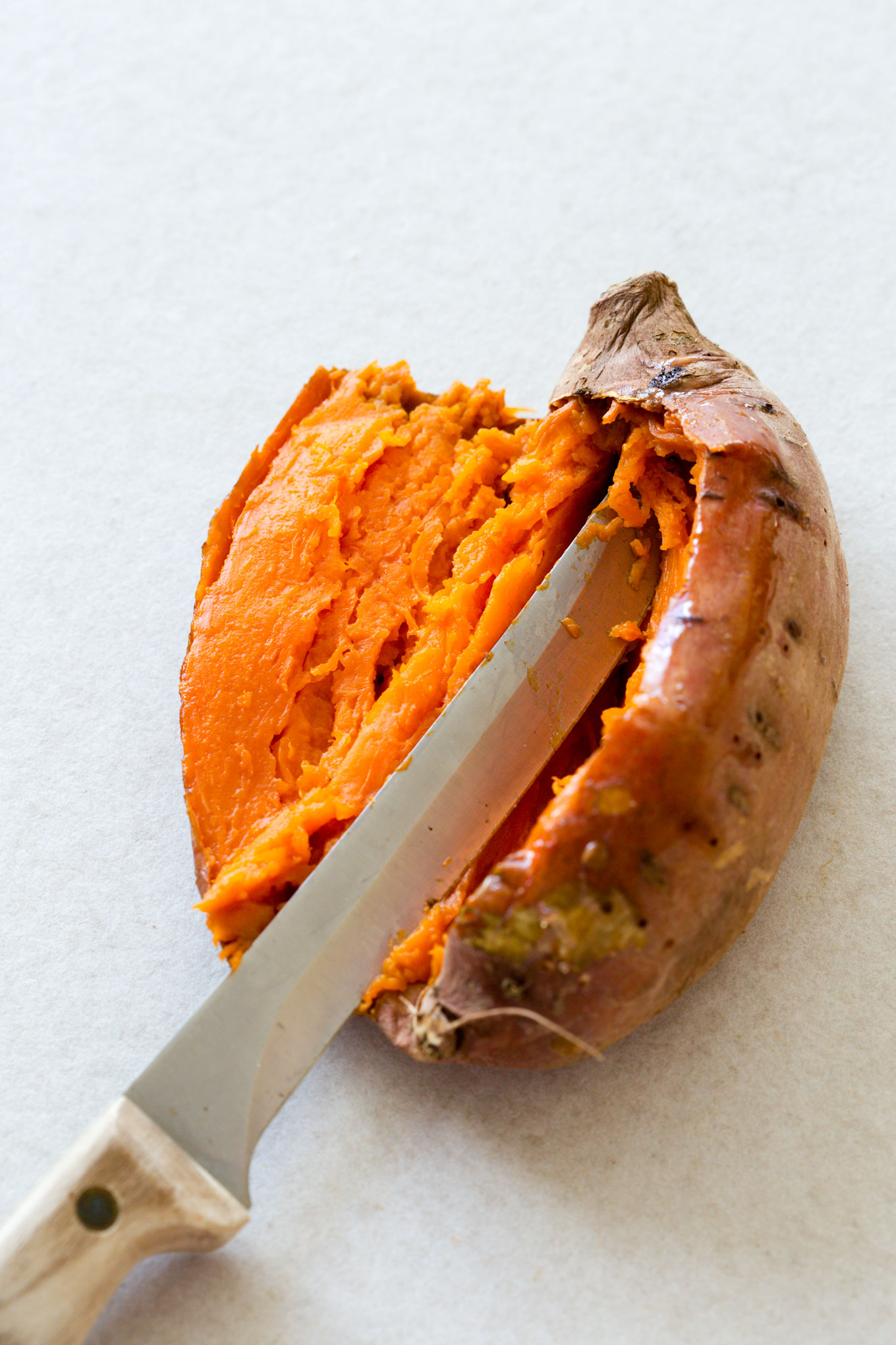 Baked Sweet Potato with a knife cut open