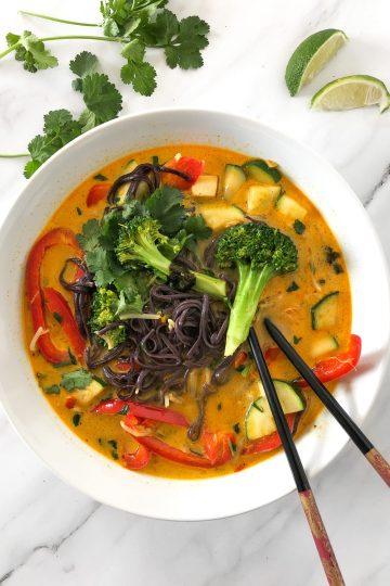 vegan laksa with tofu with chopsticks
