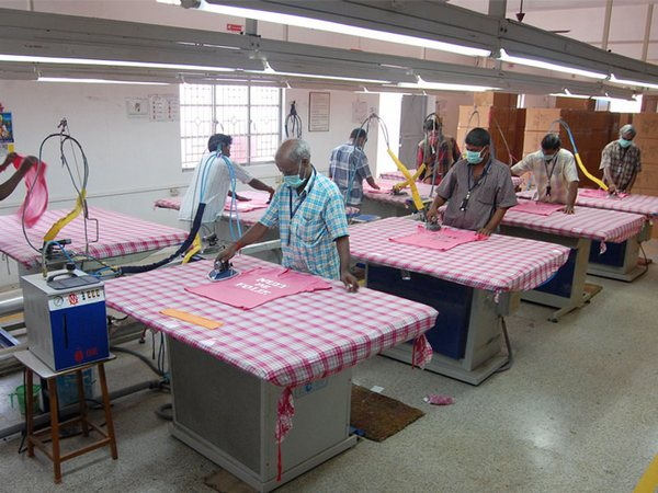 Pressing or ironing section in apparel industry