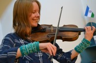 Fine, lacy, light, small, custom hand warmers for a fine fiddler