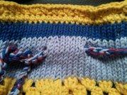 Knitted top, crochet edge.