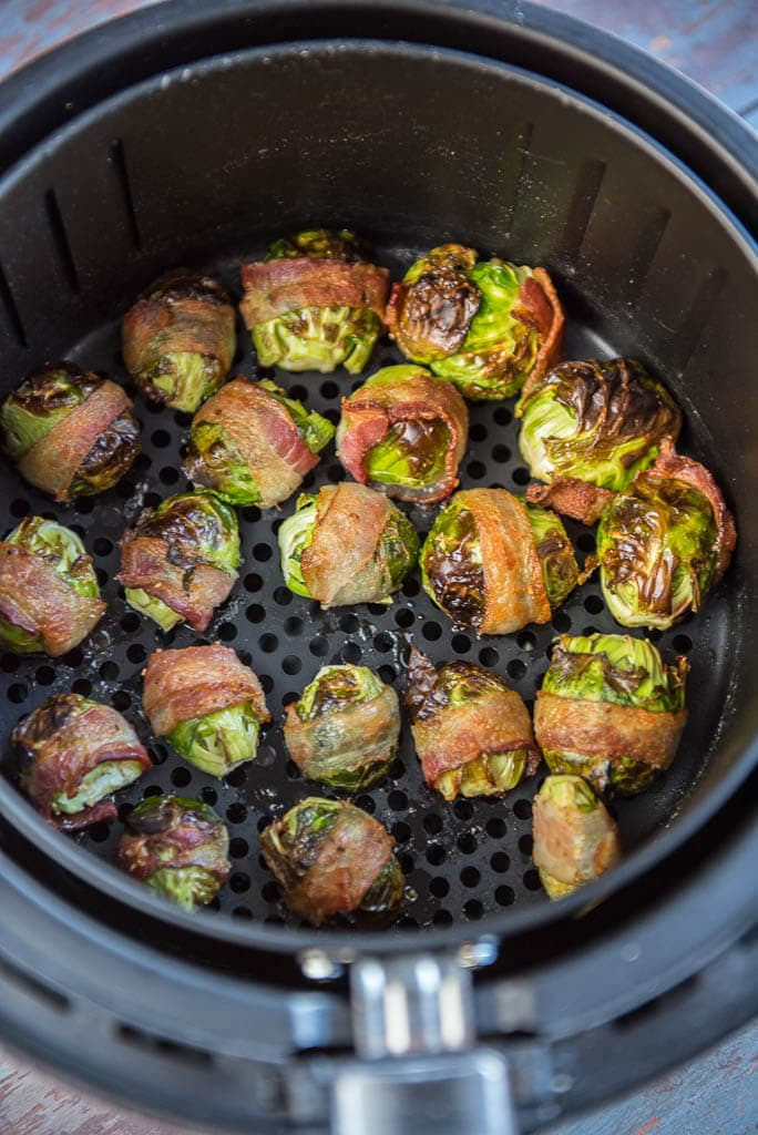 Finished in the air fryer basket to make Air Fryer Bacon Wrapped Brussels sprouts