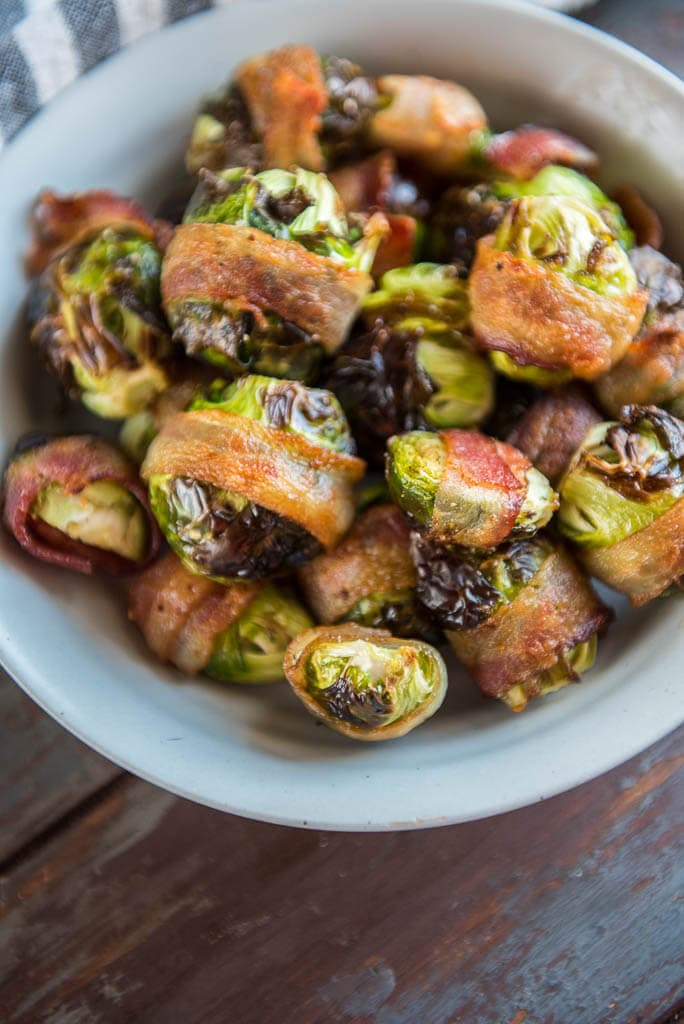 Air Fryer Bacon Wrapped Brussels Sprouts in gray bowl from overhead