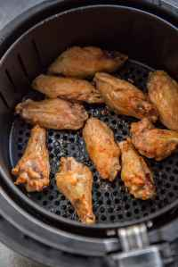 Air Fryer Chicken Wings cooked and cooling in air fryer basket