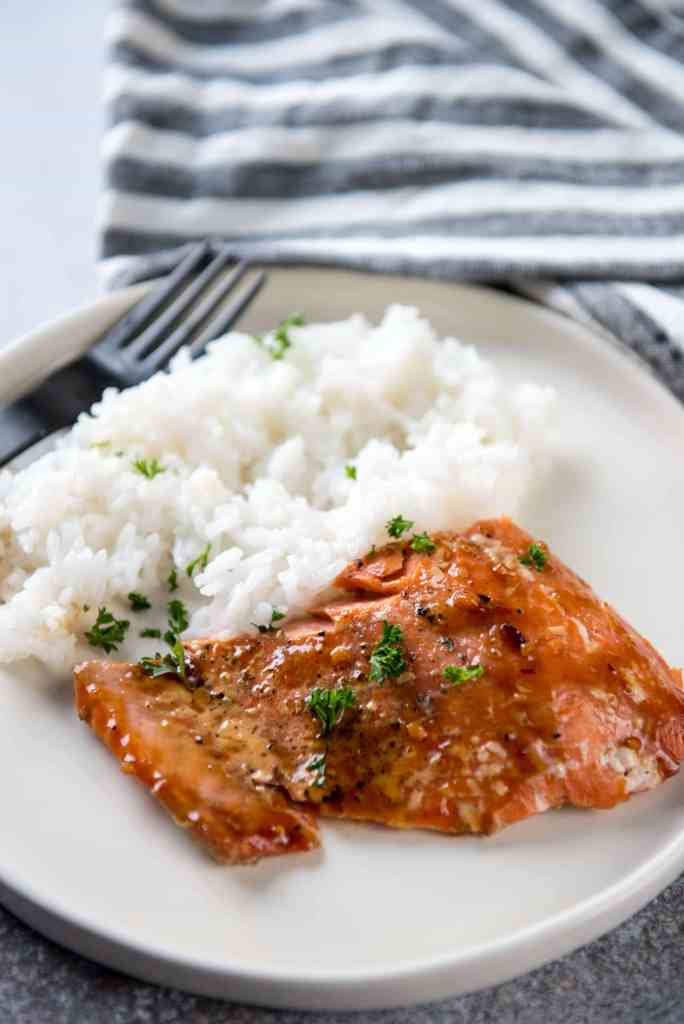 Korean BBQ Grilled Salmon on white plate with steamed rice