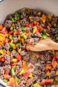 browned ground beef and peppers in dutch oven sautéing for stuffed pepper soup