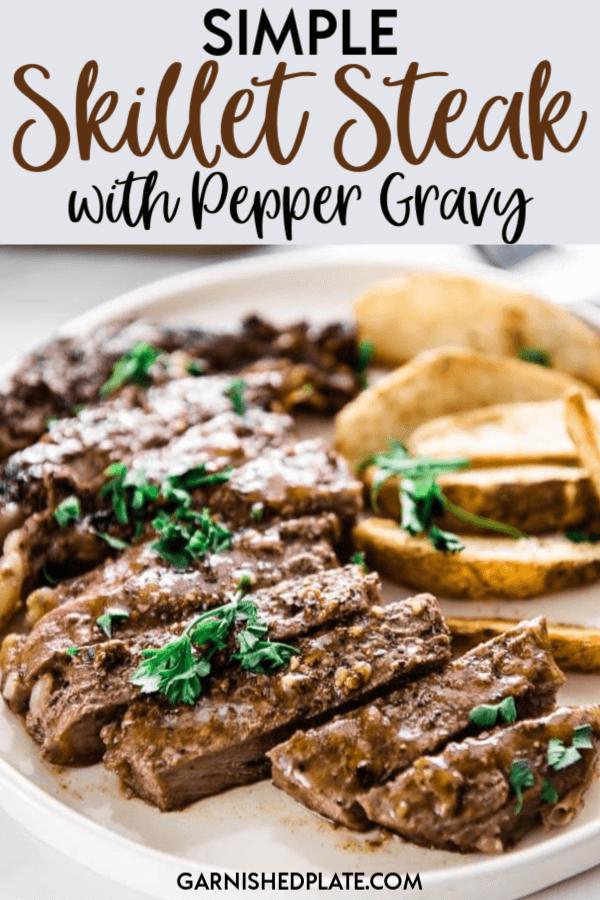 When you want a hearty meal it doesn't have to be complicated! Making a simple skillet steak with pepper gravy is a quick and easy way to get a delicious meal on the table! #garnishedplate #skilletsteak #castironsteak #peppergravy #steak #ribeye