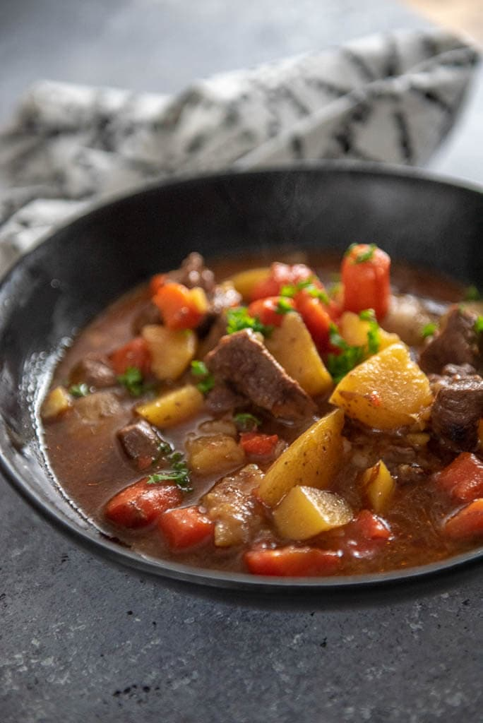 instant pot beef stew in black bowl