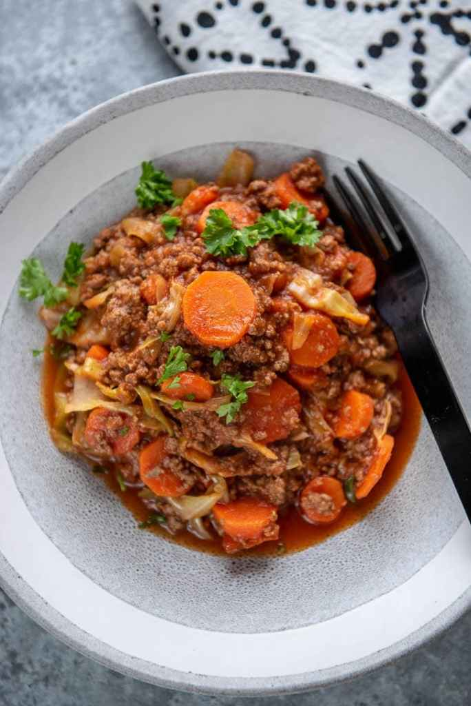 beef and cabbage casserole in a white and gray bowl