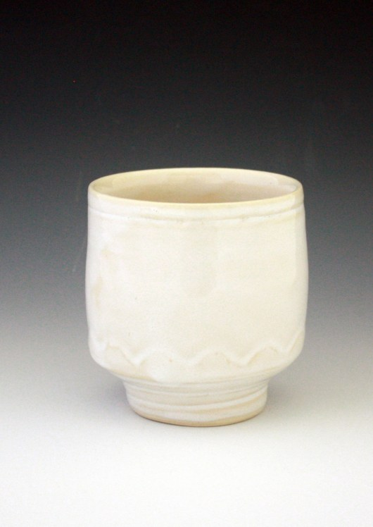 creamy white surface with nice finger decoration toward the bottom of the cup