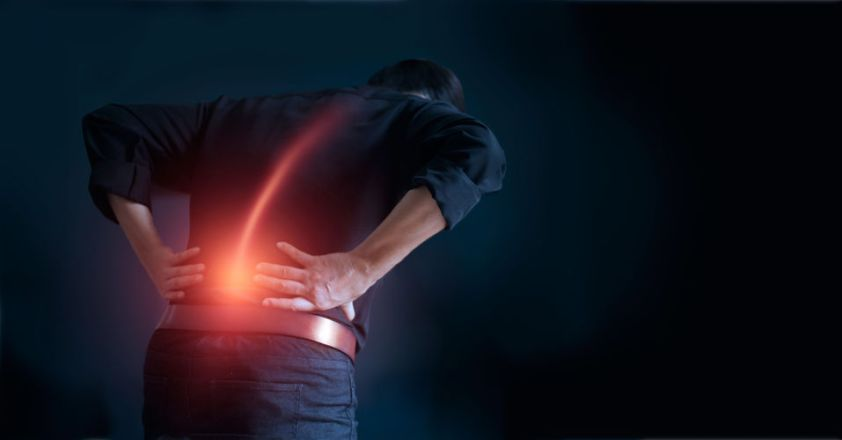 Man suffering from back pain cause of office syndrome
