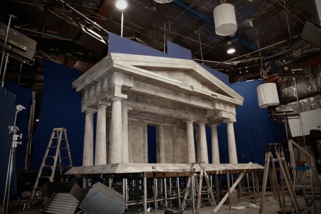 Part construction of a plaster miniature Parthenon