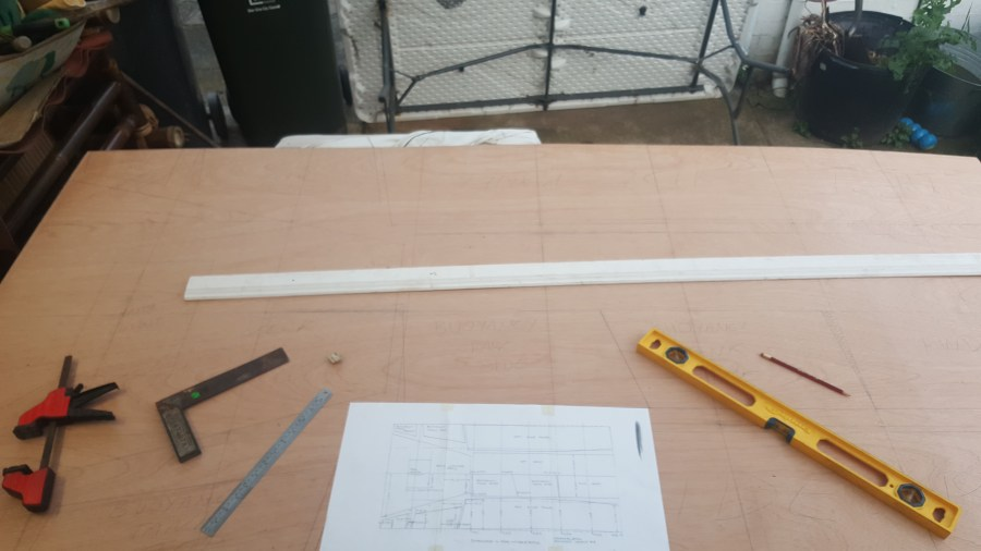 Sheet of ply with drawing tools and plans.
