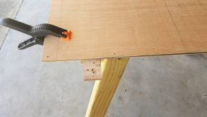 Drilling holes along the edge of the plywood panels