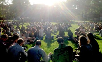 Students pray on lawn at SPU after shooting at the school.