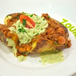 Baked potato with Chilli Con Carne and guacamole Gary Lum