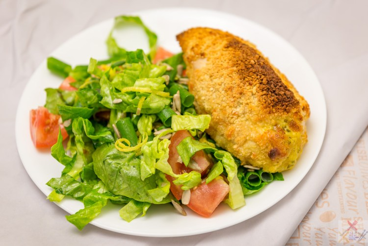 Chicken Kiev with salad (lettuce, tomato, spring onion, sunflower seeds, lemon juice, lemon zest and olive oil). The Ekka 2017 Gary Lum