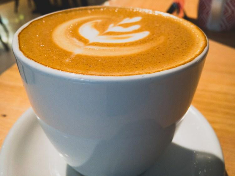 Latte in a mug at Everbean Espresso Bar Gary Lum