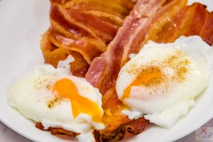 Crispy streaky bacon and poached eggs for Saturday breakfast. Stalled weight loss. Gary Lum.