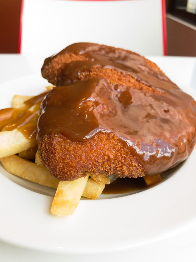 This is a photograph of Friday lunch. Chicken schnitzel with chips and gravy. I ate this at the Canberra Hospital and Health Services tuck shop.