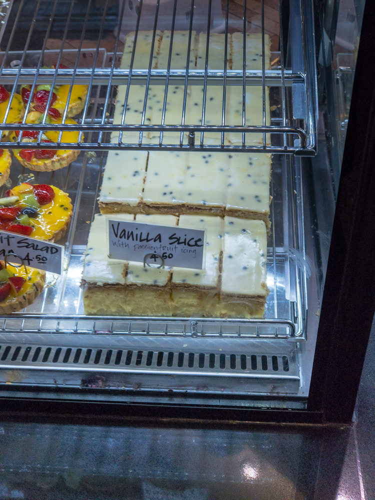 This is a photograph of Vanilla slice in the display cabinet at Dobinsons Bakery cafe, Westfield Belconnen.