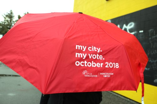 Umbrella with map of voting locations printed on interior.