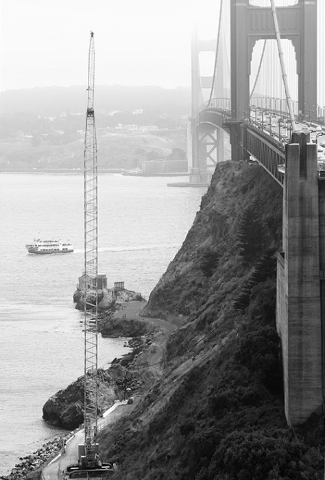 Golden Gate Bridge vertical with ferry and crane