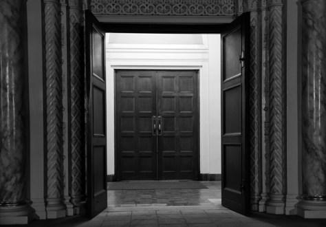 Church entrance doors at night