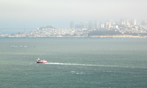 Ferry heading towards a fog veiled San Francisco