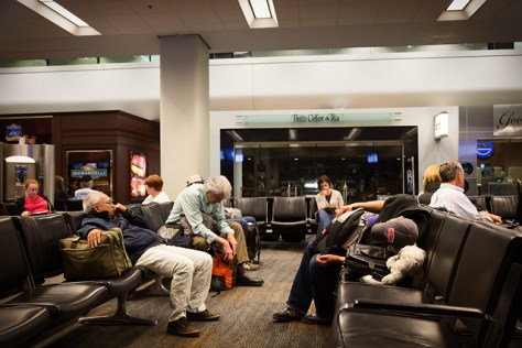 People chilling while waiting for a late night flight