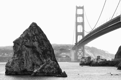 Rock and misty bridge tower