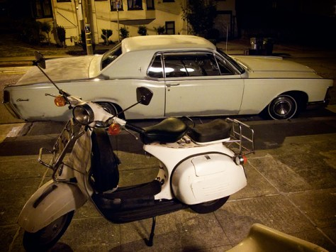 Old school Vespa and Lincoln Continental