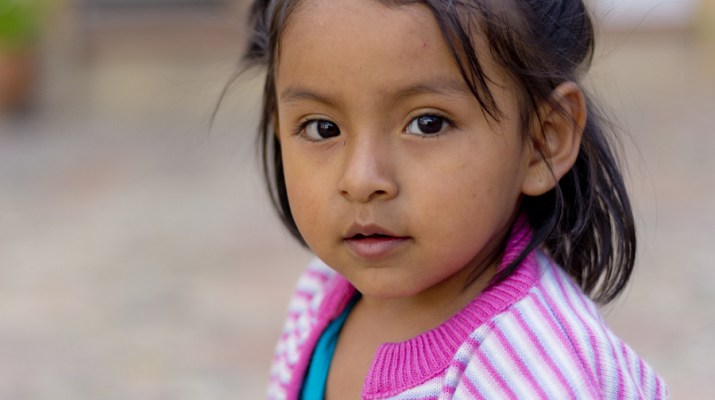 Sucre, Bolivia – January 17, 2012: A Young Girl Faces The Camera
