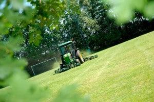 Riding Lawn Mower Cutting a Field