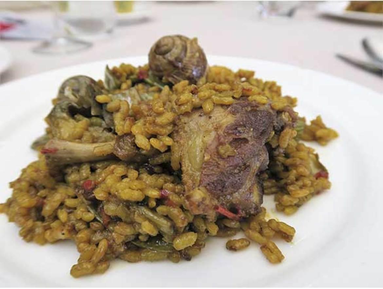 Plato de paella valenciana III Ruta de la Paella restaurante Que si quieres arroz Catalina