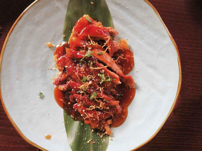 Pato Shanghai Mama crujiente en salsa de almendras Restaurante Shanghai Mama