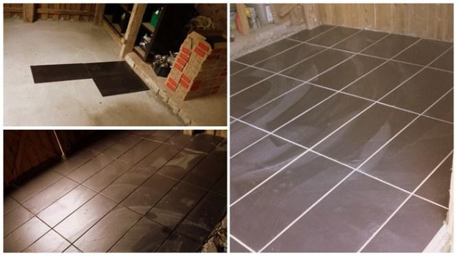 Store sorte fliser udgør gulvet i køkkenet.