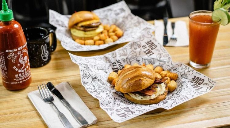 Even Stevens breakfast sandwich with brava tots