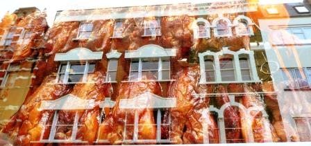 crispy ducks and Wardour Street reflected in a Chinese restaurant window, Soho