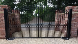 Fitted Metal Driveway Gate on Brick Pillars