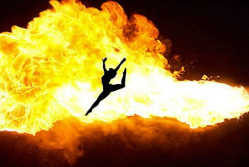 Woman dancing in front of flames