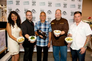 This year's four fierce competitors at the Grate Canadian Cheese Cook-Off included Bal Arneson from Vancouver; chef Andrew Farrell from Halifax; Kevin Durkee from Toronto; and chef David Bohati from Calgary with Wally Smith, president of Dairy Farmers of Canada [centre] (CNW Group/Dairy Farmers of Canada (DFC)