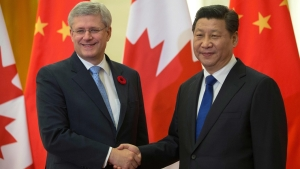 Prime Minister Stephen Harper is greeted by Xi Jinping, President of the People's Republic of China, upon his arrival at the Great Hall of the People during his official visit to China.