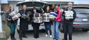 IBM donates blankets, sheets, and pillows for all 38 beds in Brenda's House, a transitional shelter for families in need. (L-R) Colleen Hardy, Brenda's House; Roy Hebert, Alberta Territory Executive, IBM Canada; Gwenn Boryski, IBM Canada; Dawn Boustead, Manager, Brenda's House; Benazeer Daruwalla, IBM Canada; Terry Heintz, IBM Canada.