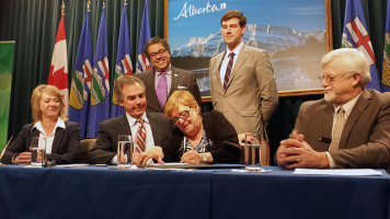 Municipal Affairs Minister Diana McQueen, Premier Jim Prentice, Alberta Urban Municipalities Association's (AUMA) President Helen Rice and Alberta Association of Municipal Districts and Counties' (AAMDC) President Al Kemmere; joined by Mayors Naheed Nenshi and Don Iveson