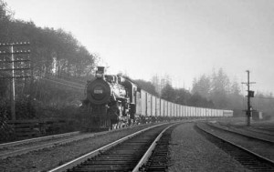 A 13-car CP silk train picks up speed as it leaves Vancouver for Eastern fashion centres in 1928. (Canadian Pacific Railway Archives photo)